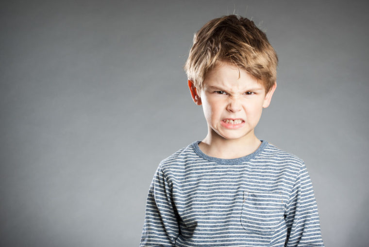 Canva portrait of boy emotion angry grey background 760x510